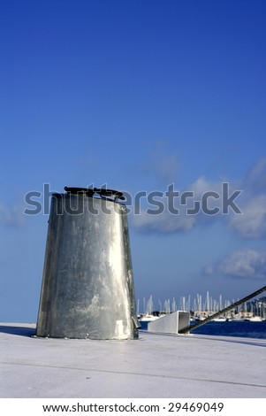 Boat stainless steel oval chimney over blue sunny sky - stock photo