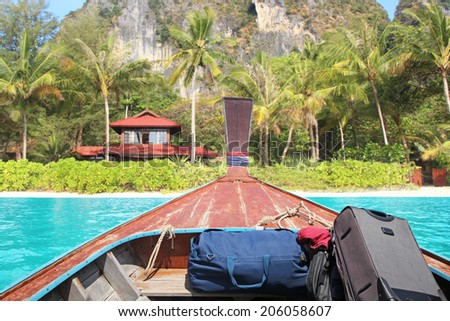 boat swims to the island - stock photo