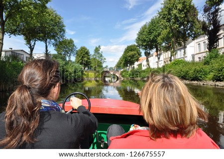 Boat trip in Friedrichstadt, germany - stock photo