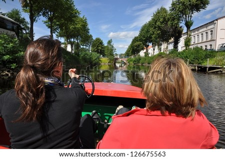 Boat trip in Friedrichstadt, germany - stock photo