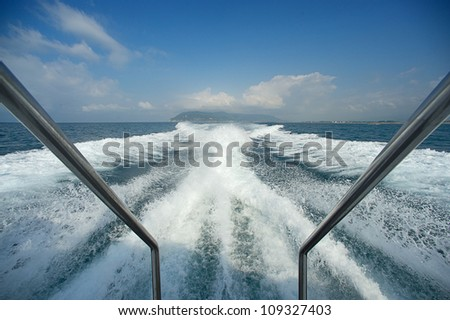 Boat wake prop wash on blue ocean sea in sunny day Italy - stock photo