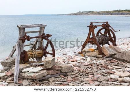 Boat winch on the shoreline - stock photo