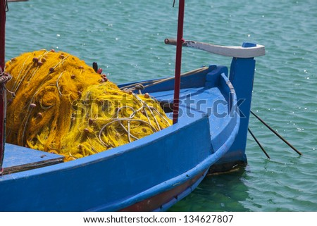 Boat with fishing net - stock photo