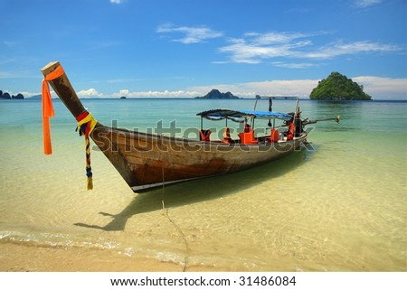 boat with tropical island - stock photo