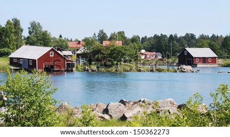 Boathouse in beautiful surroundings by the sea - stock photo