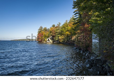Boathouse on New England lake in Fall - stock photo