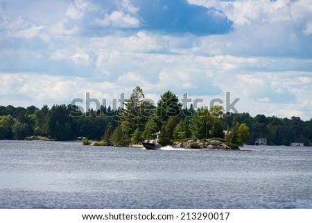 Boating on Lake Muskoka - stock photo