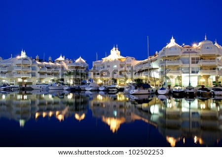 Boats and apartments in the marina at night, Benalmadena, Costa del Sol, Malaga, Province, Andalusia, Western Europe. - stock photo