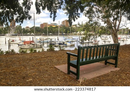 Boats and yachts moored in the Brisbane River by the Brisbane City Botanical Gardens in Queensland Australia. - stock photo