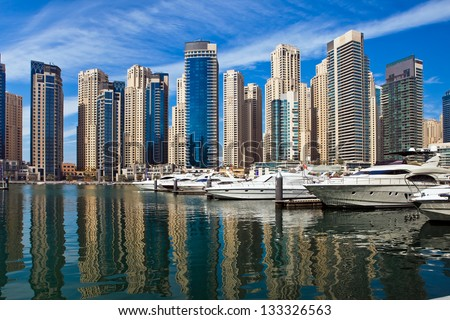 Boats and yachts parked in famous Marina district in Dubai, UAE. - stock photo