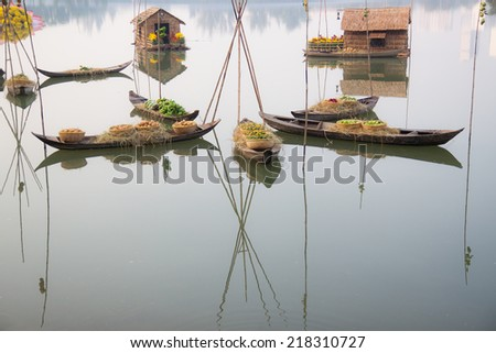 Boats are carrying flowers in the occasion of Lunar New Year - stock photo