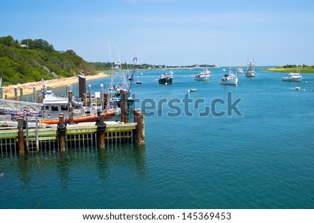 Boats are moored in a bay near the Chatham Fish Pier, MA, on Cape Cod. - stock photo
