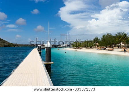 Boats around a pontoon  Views around Curacao a Caribbean Island  - stock photo