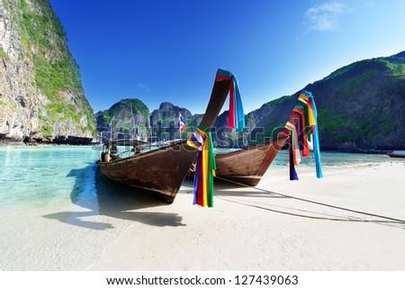 boats at Maya bay Phi Phi Leh island, Thailand - stock photo