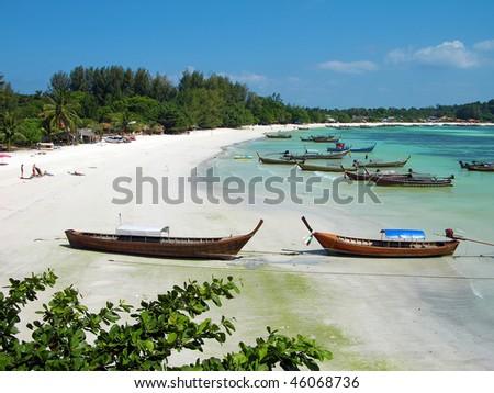 Boats at Pattaya beach on Lipe island, Andaman sea, Thailand - stock photo