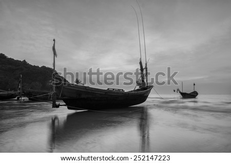 Boats at the beach during sunset seascape in thailand black and white tone. - stock photo