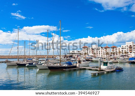 Boats at the Marina harbour in Agadir. Agadir is a major city in Morocco located on the shore of the Atlantic Ocean, near the Atlas Mountains. - stock photo