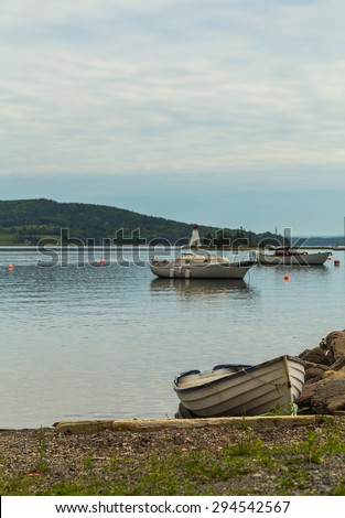 Boats at the waterfront in Baddeck, Nova Scotia during the day. There is space for text. - stock photo