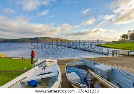 Boats beside Kielder Water - stock photo
