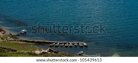 boats by the shore of isla del sol, lake titicaca in Bolivia - stock photo