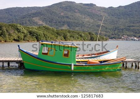 Boats docked at Costa da Lagoa in Florianopolis, Santa Catarina, Brazil. - stock photo