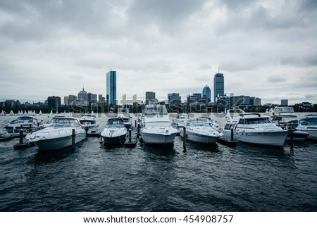 Boats docked on the Charles River and view of the Boston skyline, in Cambridge, Massachusetts. - stock photo