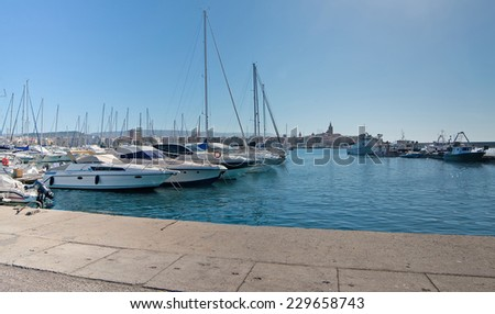 boats in Alghero port on a clear day - stock photo