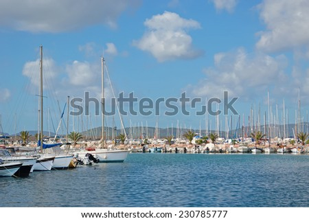 boats in Alghero port on a cloudy day - stock photo