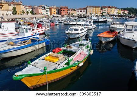 Boats in marina of Rovinj, Istria, Croatia. Typical mediterranean seaside town. - stock photo