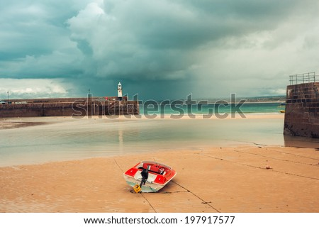 Boats in St. Ives harbour at low tide - stock photo