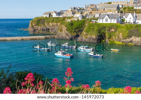Boats in the harbour at Cornwall fishing village of Port Isaac England UK on a beautiful sunny day - stock photo