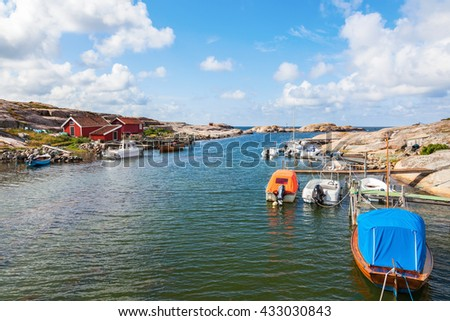 Boats moored at the pier of the bay - stock photo