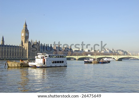 Boats moored in front of the Houses of Parliament in London, England - stock photo