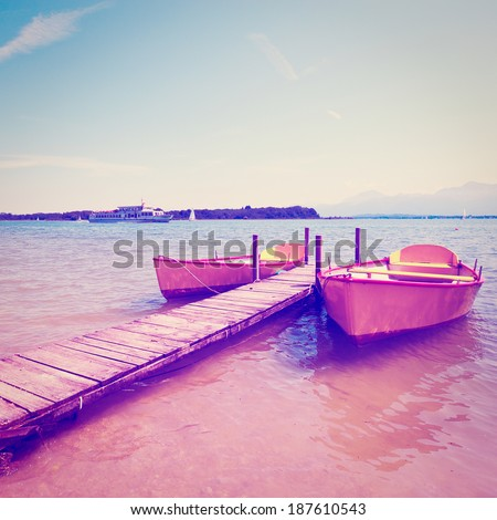Boats Moored on the Lake  Chiemsee, Instagram Effect - stock photo
