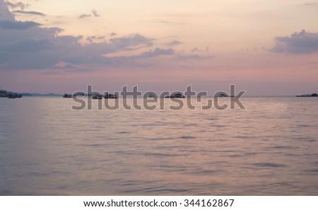 Boats near Pattaya beach in the evening - stock photo