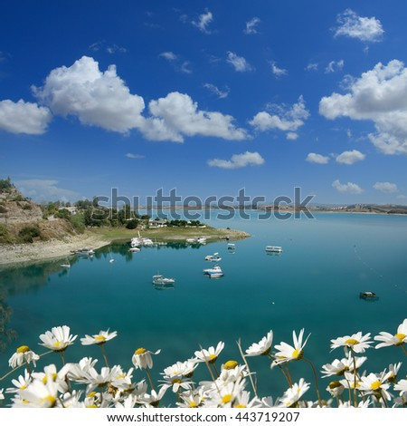 boats on a lake over clear sky - stock photo