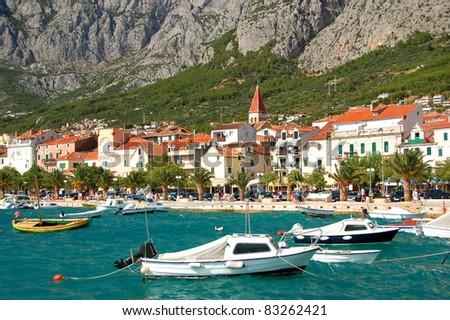 boats on restless adriatic sea in makarska, croatia - stock photo