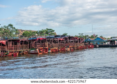 Boats on Siem Reap Riverbanks - stock photo