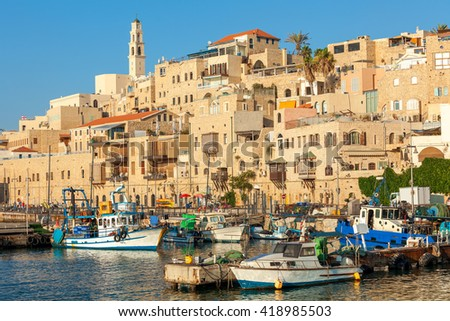 Boats on small harbor and old houses in Jaffa, Israel. - stock photo