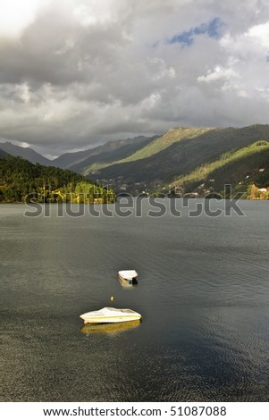 Boats on the river Caldo, Geres National Park, north of Portugal - stock photo