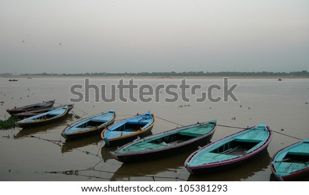 Boats on the river Ganges in the holy city of Varanasi, India - stock photo
