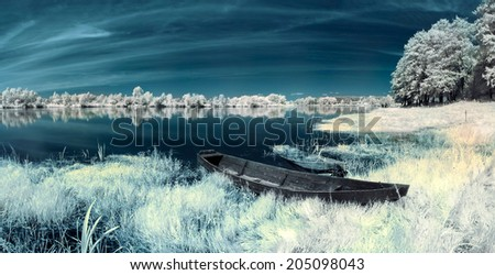boats on the river in the infrared - stock photo