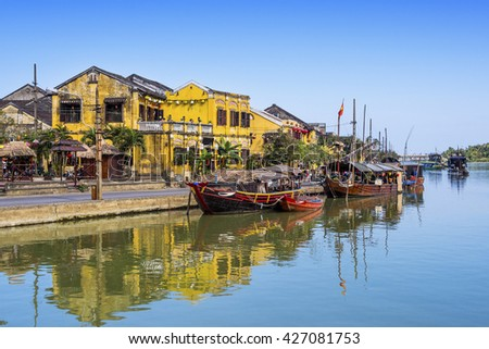 Boats on the Thu Bon River in Hoi An Ancient Town, Vietnam. - stock photo