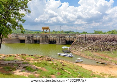 boats park at front of Ubonrat Dam, khonkaen, Thailand.Show low level water because of drought. - stock photo