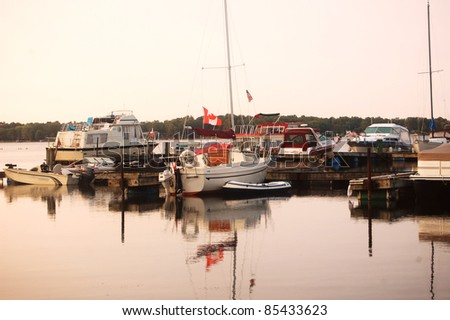 boats parked in the ocean shore village on a calm morning - stock photo