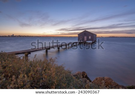 Boatshed at Swan River, Perth in sunrise - stock photo