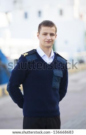 boatswain near the boat - stock photo