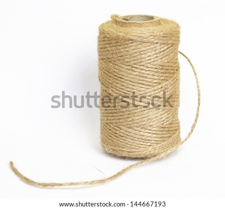 bobbin of the natural  country thread isolated on white background - stock photo