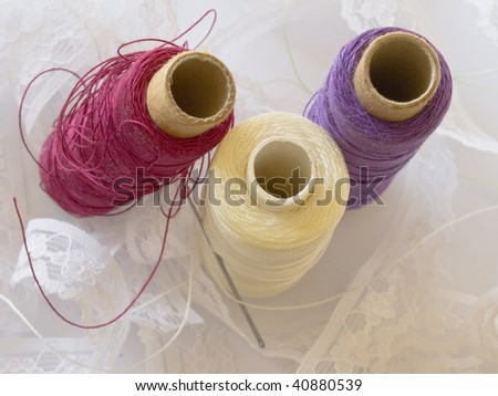 bobbins and lace - stock photo