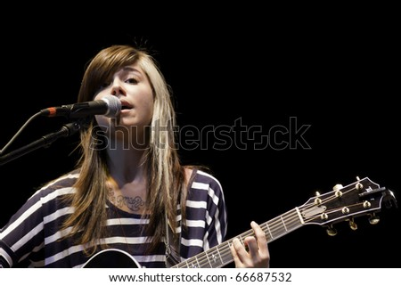 BOCA RATON, FLORIDA, USA - DECEMBER 4: Singer and song writer Christina Perri performs on stage at No Snow Ball 2010 - December 4th, 2010 in Boca Raton, Florida, USA. - stock photo